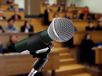 Microphone on podium at a keynote speech event